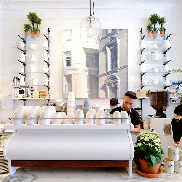 <strong>Toby's Estate Coffee</strong> <br><br> New York City locals take their coffee seriously–very seriously. Instead of stopping in to grab a latte at a run-of-the-mill Starbucks, get your caffeine boost at Toby's Estate instead. Our favourite location of Toby's is located in Club Monaco's Flatiron flagship boutique. There are a few other locations, but this one is probably our favourite–it sits right alongside Club Monaco's chic add-ons to their already well designed shop, which features a Putnam & Putnam flower shop and Strand books for sale all under one well-decorated roof. These guys are one of the few that roasts their own ethically-sourced beans, and the cosy seating area is just too inviting to resist—especially when that 3:00p.m. feeling comes on.