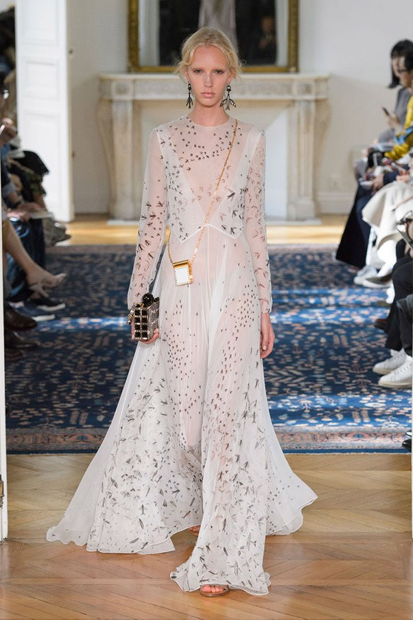 <strong>Bridal Party</strong> <br><br> Airy whites, blanc florals and intricate lace add up to the sort of other-worldly ethereal gowns that brides may dream about, but are made for pretty-loving party-goers everywhere. Pictured: Valentino