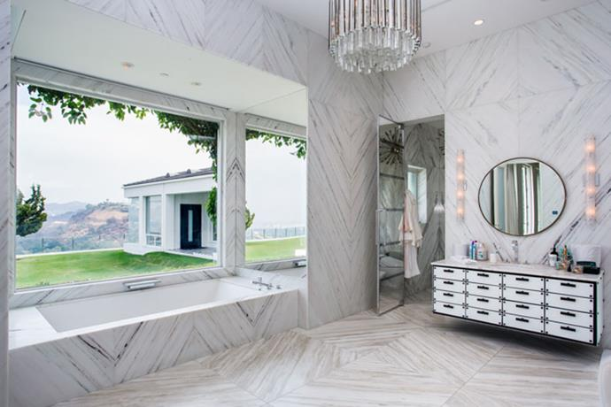 With an all-white marbled bathroom with views over the Hills, what more could you want?