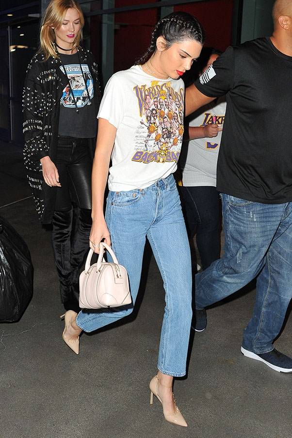 Jenner was seen sporting a denim/basketball tee combo at an LA Lakers game with model pal Karlie Kloss.