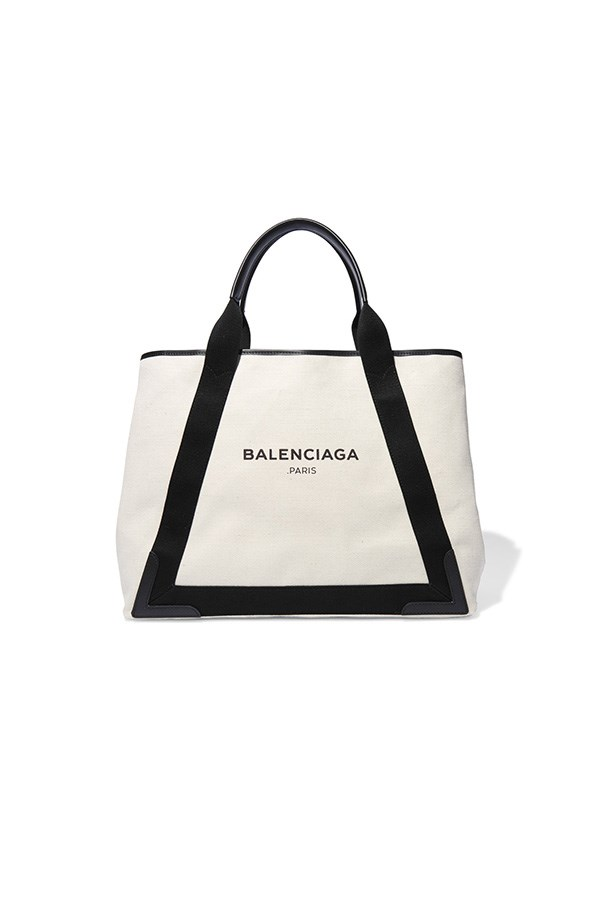 """<strong>A beach bag</strong><br><br> The classic: Stick to your guns with a tried-and-tested shape that has lasted season after season.<br><br> Buy: Balenciaga canvas tote, $1,525, <a href=""""https://www.net-a-porter.com/au/en/product/663477/Balenciaga/cabas-leather-trimmed-canvas-tote"""">Net-a-Porter</a>"""