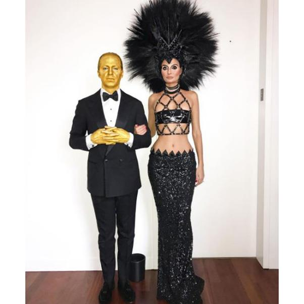 """<strong>Giovanna and Oscar Engelbert</strong><br><Br> As Cher and her Oscar.<br><br> Instagram: <a href=""""https://www.instagram.com/p/BMKcxc_BIqc/?taken-by=bat_gio"""">@bat_gio</a>"""