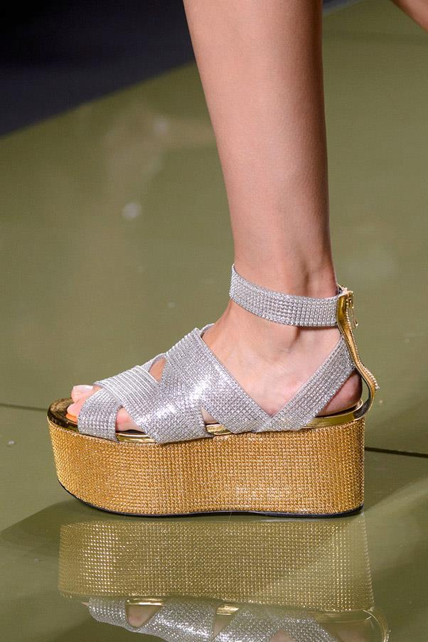 <strong>Good (Flat) Form </strong><br><br> And just like that, flatforms are back. Consider it all the height, none of the pitch, with wooden takes at Balmain, sporty iterations at Dolce, Teva inspiration at Versace and white leather at Gucci. <br> Pictured: Balmain