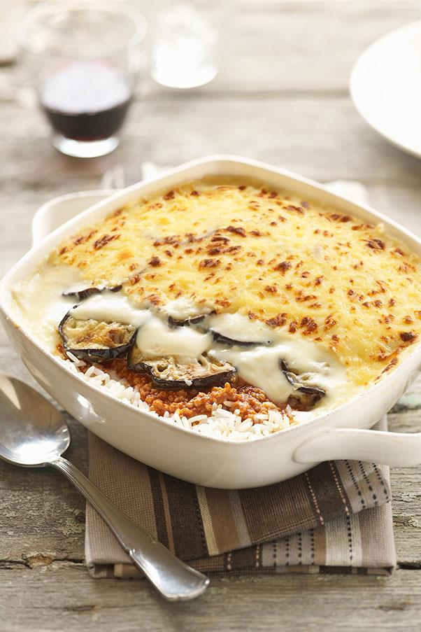 """<strong>MOUSSAKA </strong><br> moo-sah-KAH <br> <em>Dish of ground meat (such as lamb or beef) and layered sliced vegetables, often eggplant, with bechamel sauce.</em> <br> Even the Oxford English Dictionary gets this wrong- it's not the commonly said """"moo-SAH-kah"""" nor is it """"MOO-sah-kah."""" The preferred foodie and Greek restaurant pronunciation of this famous dish has the accent on the last syllable, just like the Greek word for this dish <em>moussakas</em>. (But in English we just leave off the last s.) <br> So when in Greek restaurants, do as the Greeks do, order """"moo-sah-KAH."""" But maybe you shouldn't tell your Greek waiter what the Oxford English Dictionary says about this dish so beloved in Greece- that the word actually came to Greek via their once arch-enemies, the Turks, from the Arabic word <em>musaqqa</em>, """"that which is fed liquid,"""" referring perhaps to the bechamel sauce. Just stick with the correct accent and you'll be fine."""