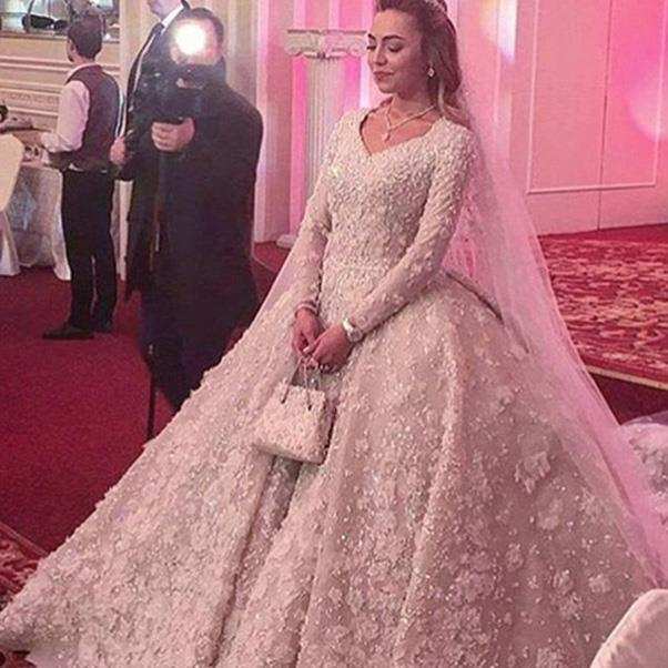 "<strong>The extravagant wedding dress</strong><br><br> Wedding one: Khadija Uzhakhovs in Elie Saab. <br><br> Image: Instagram <a href=""https://www.instagram.com/p/BDiYO0LM2_p/"">@svadby_miira_lux</a>"