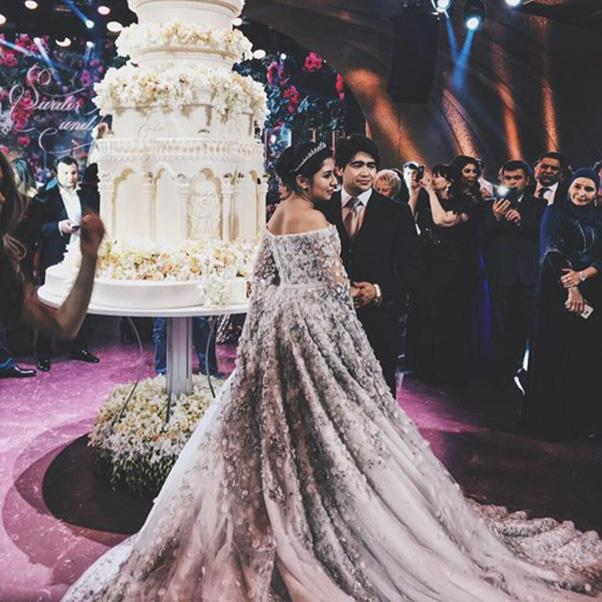 """<strong>The extravagant wedding dress</strong><br><br> Wedding three:  Madina Shokirova in a $800,000 Ralph & Russo gown. <br><br> Image: Instagram <a href=""""https://www.instagram.com/p/BMT0KPJhw2A/"""">@katerinaleshina</a>"""