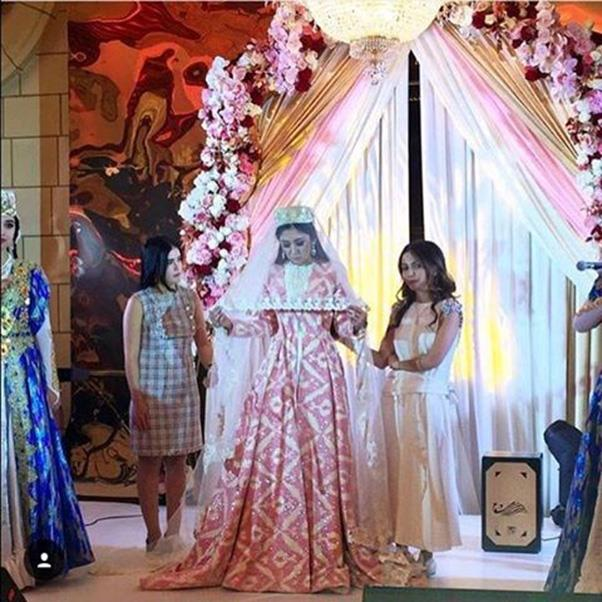 "<strong>The second, traditional wedding dress</strong><br><br> Wedding three: Madina Shokirova <br><br> Instagram: <a href=""https://www.instagram.com/p/BMOPtroDHMQ/"">@mursak.boutique</a>"