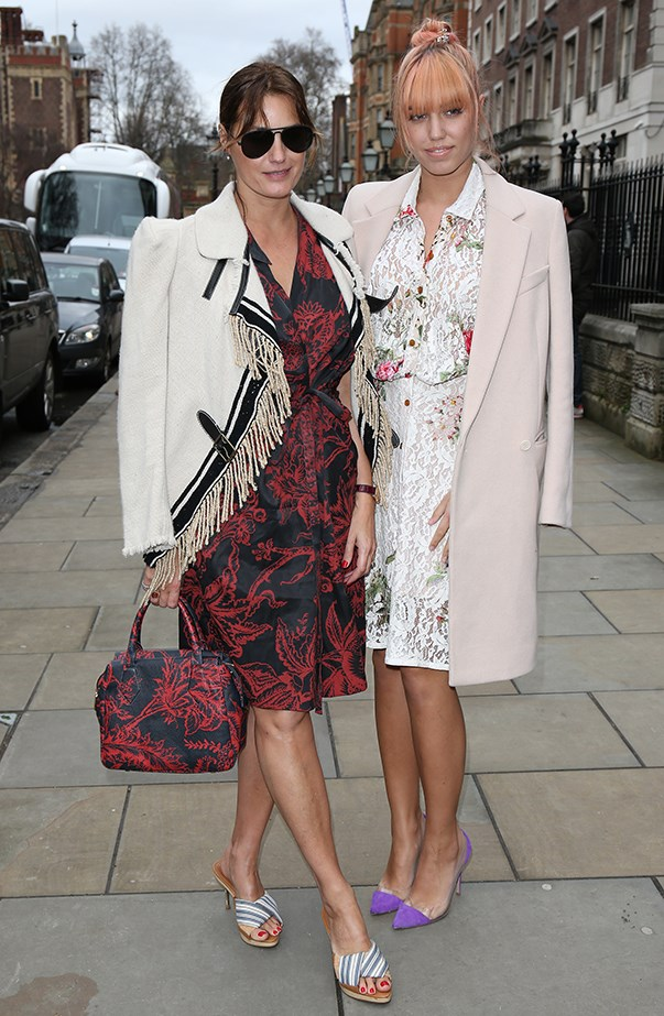 <p><strong>Yasmin Le Bon and Amber Le Bon</strong> <br><br><p>Modest, printed knee-length dresses? Check. Coats worn hanging off their shoulders? Check. Yasmin and Amber were on the same style wavelength during London Fashion Week earlier this year.