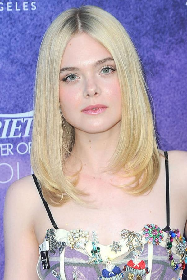 <strong>4. Long Layers</strong><br><br> Centre-parted hair with flippy ends on Elle Fanning.