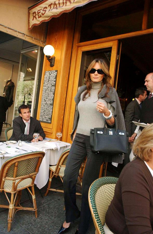 Melania opting for a grey turtleneck and black Hermes Birkin in 2005.