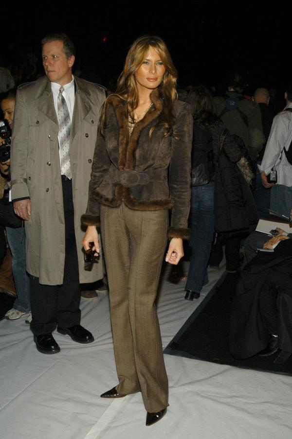 Trump in rugged up in brown at the Vera Wang show during Olympus Fashion Week in 2005.