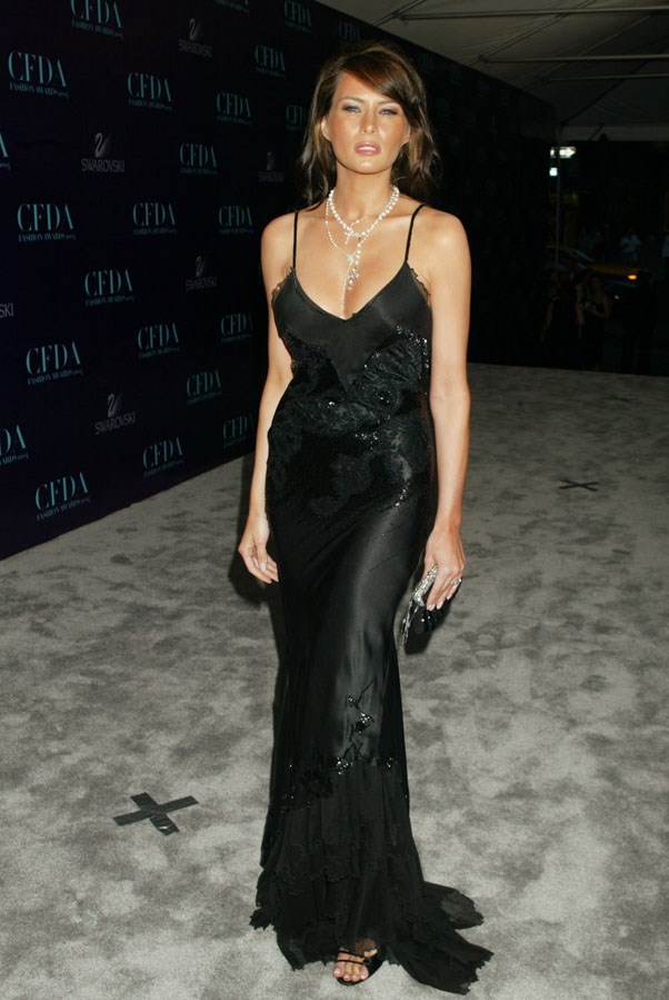 Melania wearing a plunging black satin gown in 2004 at the CFDA Fashion Awards in New York.