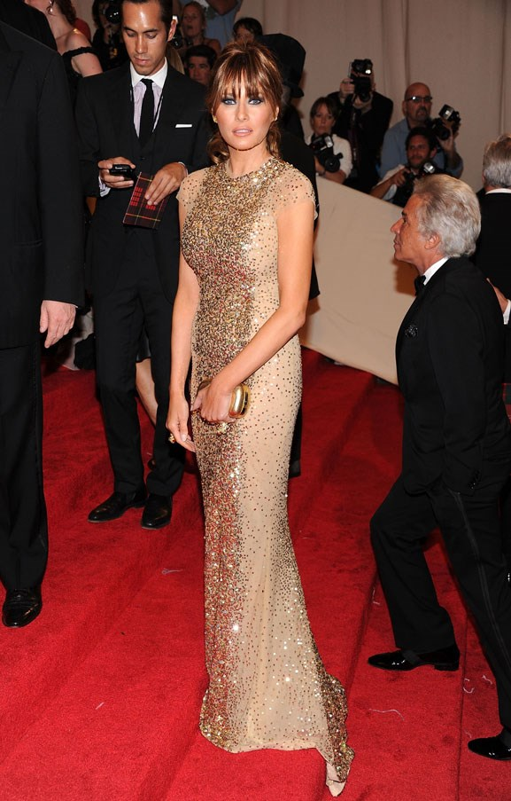Trump wearing a floor-length golden gown at the 2011 Met Gala.