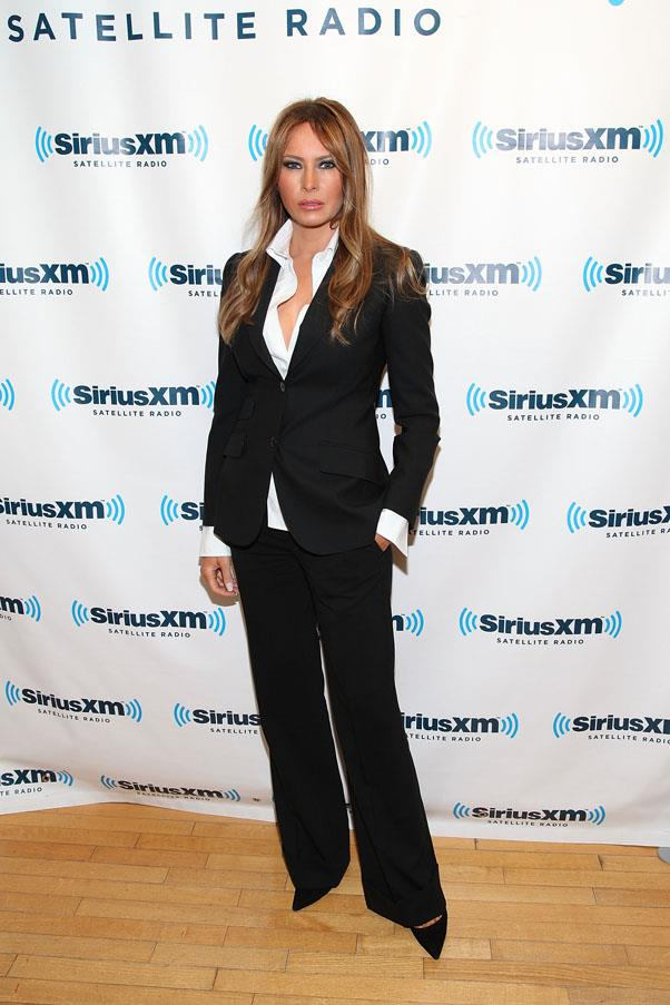 Known mostly for wearing bold colouring, Melania opted for an all black pant-suit in 2011.