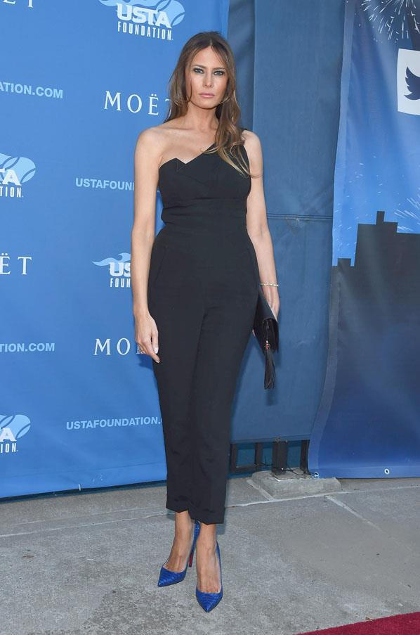 Melania Trump attends the 14th Annual USTA Opening Night Gala wearing a black jumpsuit and electric blue pumps in 2014.
