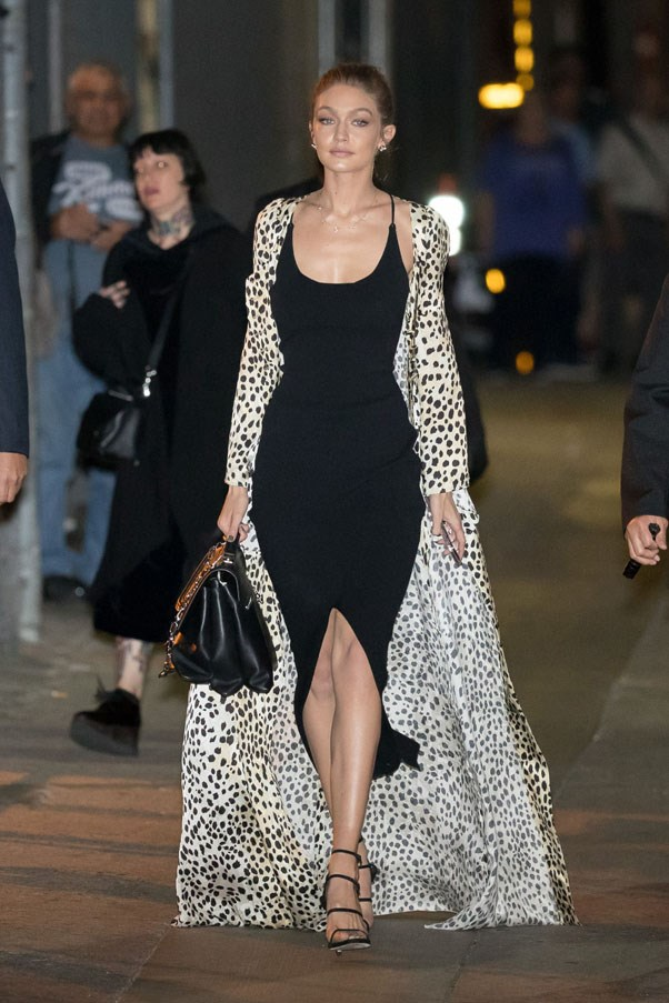 Hadid stepped out in a black Nanushka slip dress and Stuart Weitzman sandals in New York.