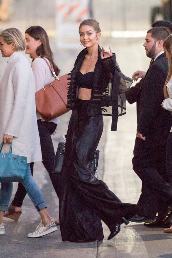 On her way to <em>Jimmy Kimmel Live!</em>, Hadid couples a black crop and sheer jacket with high-waisted pants.