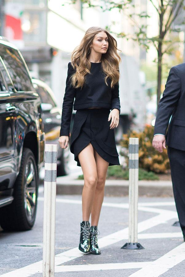 Hadid stepped out in her own Gigi boot for Stuart Weitzman, a black cashmere sweater and layered asymmetrical skirt by Brandon Maxwell to attend her Victoria's Secret fittings.