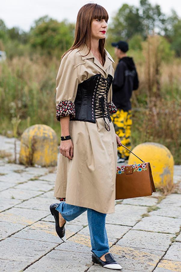 This Milan show-goer proves the power of letting the corset sit front and centre. If you're going to go this bold, stick to a neutral palette of camel and denim. <br><br> Image: Jason Lloyd Evans