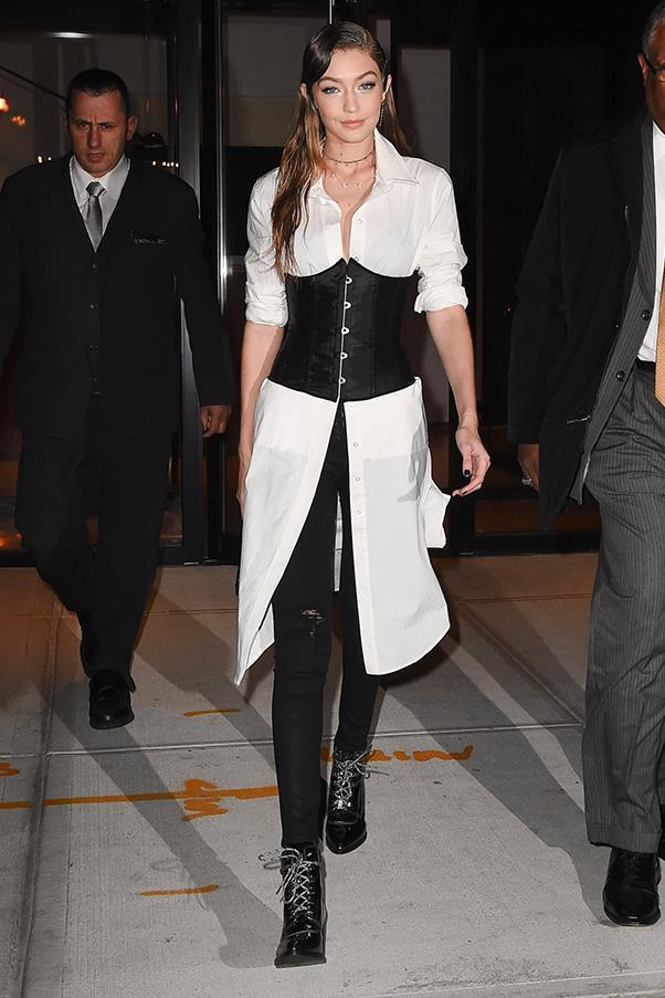 Make the aforementioned shirt and corset combo evening-appropriate by rocking a half-buttoned shirt dress over skinny jeans like Gigi Hadid.