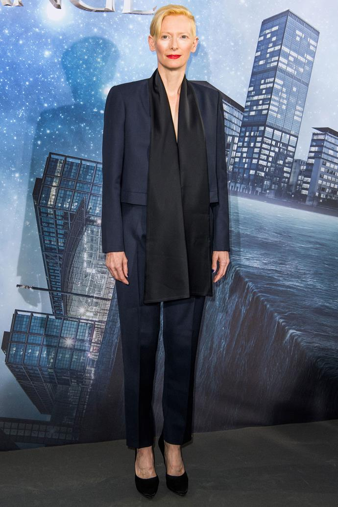 <strong>TILDA SWINTON</strong> <br><BR> <strong>October 2016</strong>: Queen of the trouser suit, Tilda Swinton, rocks a simple yet elegant navy suit and scarf combo.