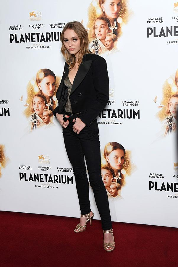 Lily-Rose Depp breathes new life into the black skinny jean with a party-appropriate top at the premiere of <em>Planetarium</em>.