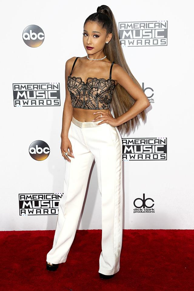 In a sea of gowns and glitter Ariana Grande stood out at the AMAs in a vintage lace crop and Alexander McQueen trousers.