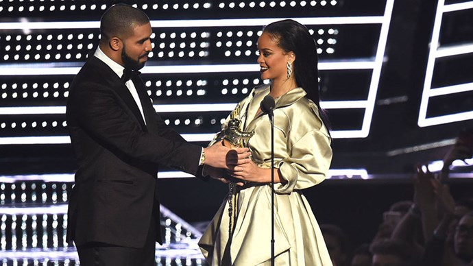 """<strong>Rihanna and Drake</strong> <br><br> Though we never fully got confirmation of an official Drake and Rihanna relationship <em>or</em> breakup, something <em>definitely </em>went on and fizzled out between these two this year. The on-and-off-again duo collaborated for the singer's steamy """"Work"""" music video, kicking off a series of flirt-filled performances throughout spring and summer. It escalated to the next level when Drake bought a billboard to congratulate Riri and then surprised everyone at the VMAs to present her the Vanguard Award where he admitted he's """"been in love with Rihanna since he was 22."""" Despite their matching tattoos, saying """"I love you"""" and flirty performances, the couple reportedly broke up in October—for now, that is."""