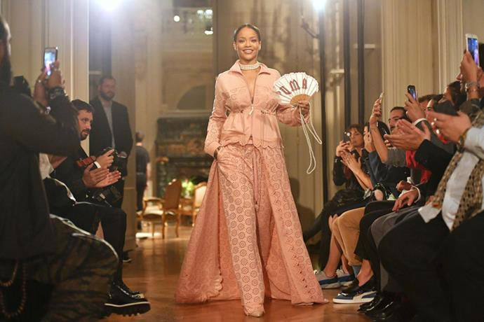 """<strong>Bad Gal Riri Hits Paris Fashion Week</strong> <br><br> As if Rihanna's Fenty Puma creepers and furry slides didn't dominate 2016 themselves, the singer/designer also headed to Paris to stage her second Puma collection. Making her Paris Fashion Week debut, she unveiled a collection inspired by """"Marie Antoinette if she went to the gym"""" as only Bad Gal Riri could do. For her runway bow, she wore a pink lace suit, pearl choker and Puma fan—reminding us all of her style icon status."""