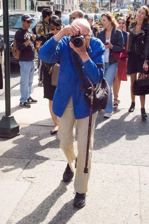 """<strong>A Fashion Legend is Lost</strong> <br><br> In June, the fashion world mourned the loss of beloved photographer, Bill Cunningham. The 87-year-old icon died following a stroke, creating a noticeably empty space in the industry—namely on the street style scene, during Fashion Week and at New York's most prestigious events. To commemorate him, Cunningham's go-to street style corner (57th and 5th) was renamed """"Bill Cunningham Corner"""" in July and then during the first New York Fashion Week without him, photographers paid tribute to the legend by all wearing his signature blue jacket."""