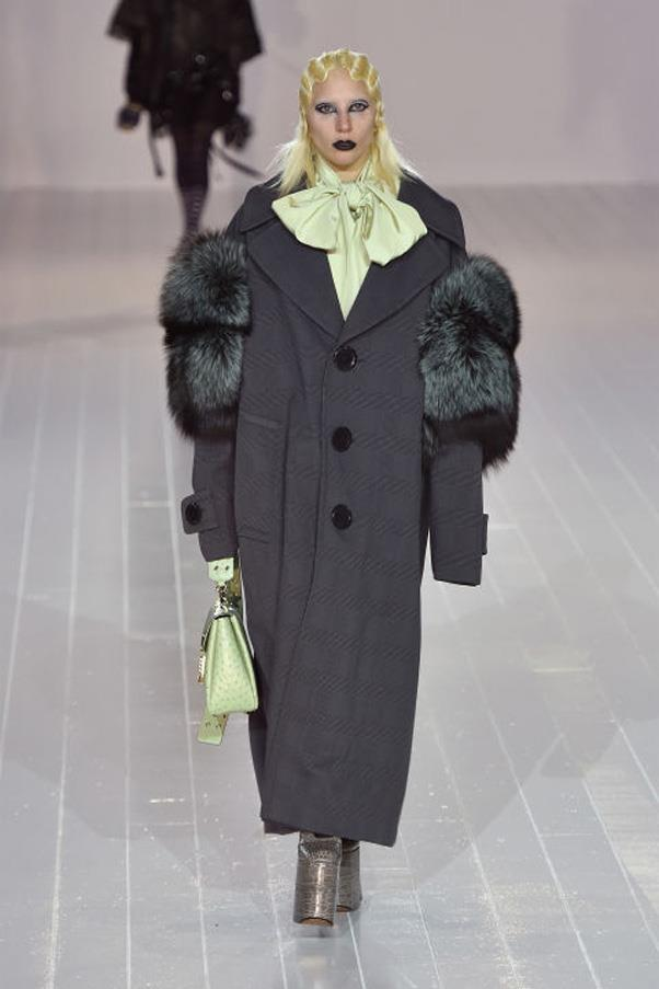 <strong>Lady Gaga Morphs Into a Runway Model</strong> <br><br> Hidden amongst the lineup of Marc Jacobs' Fall 2016 show was none other than Lady Gaga—who walked the runway in an oversized coat and towering platform heels. Like all the other models in the show, the singer had her hair bleached for the occasion. Gaga's appearance marked NYFW's biggest star-studded runway cameo of the season