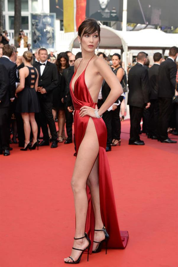 <strong>Bella Hadid Takes Slits To New Heights</strong> <br><br> Without a doubt, the younger Hadid sister was the emerging model-to-watch in 2016. Though she certainly won the model off-duty style scene this year, the model also won the Cannes Film Festival red carpet in the sexiest dress of the year. Hadid showed up in a silky red Alexandre Vauthier Couture gown with sky-high slits that left very little to the imagination and narrowly escaped a wardrobe malfunction.
