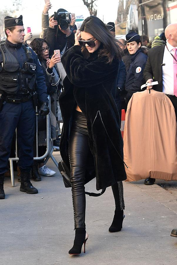 Jenner rocks a go-to all black ensemble in Paris, wearing leather leggings and a black fur coat before the Victoria's Secret Fashion Show.