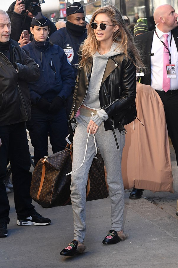 Gigi does 'casual Friday' like no other; dressing up a grey tracksuit with Gucci fur slippers and a leather biker before the Victoria's Secret Fashion Show in Paris.