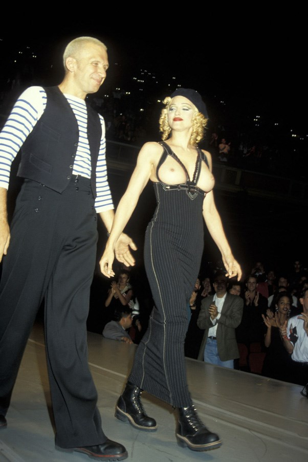 """<strong>MADONNA</strong> <br><br> Back in 1992, Madonna made her catwalk debut for Jean Paul Gaultier at his amFAR extravaganza wearing nothing but a tube dress and the frame of the bra. """"I was supposed to wear a top and jacket like Jean Paul's, but at the last minute I decided it was better to go out topless,"""" she said on the night."""