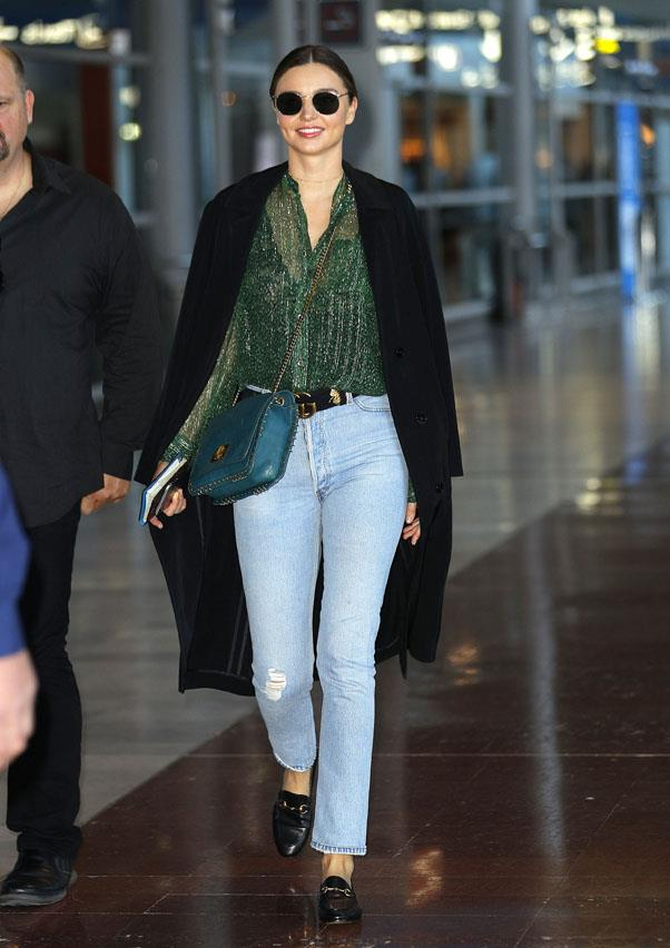 <strong>October 4, 2016</strong><br><br> Kerr does a matching Gucci combo of shoes and a belt paired with blue jeans and a gossamer blouse.