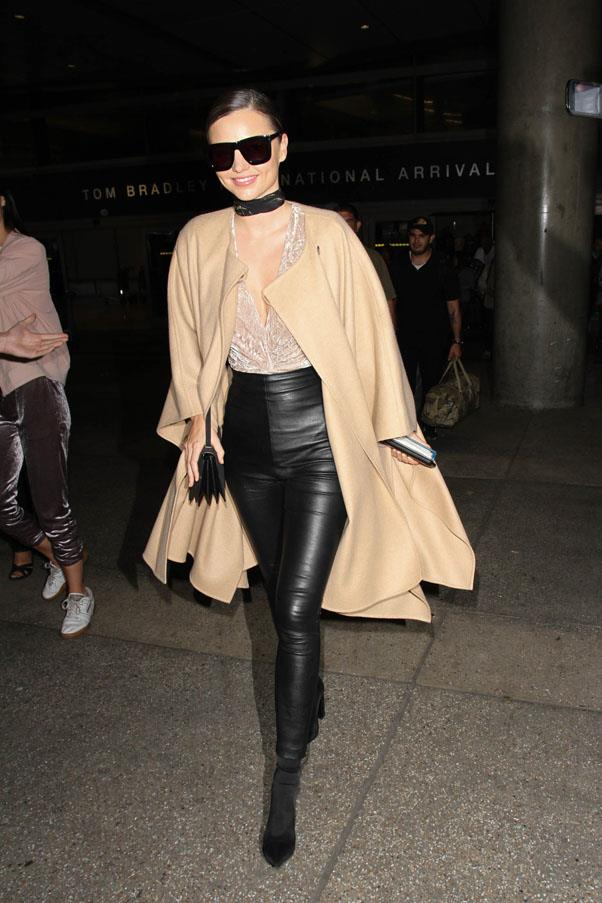 <strong>October 5, 2016</strong> <br><br> Wearing her staple oversized sunnies and leather leggings paired with a camel coloured coat.