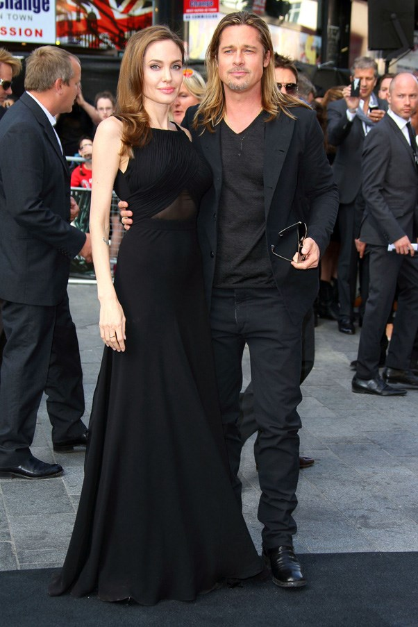 "<strong>ANGELINA JOLIE AND BRAD PITT</strong> <br><br> Famous for saying they would not wed until gay marriage was legalized, Brangelina finally gave in, saying ""I do"" at their home, Chateau Miraval, in France. The bride wore a Versace gown customized with her children's drawings."
