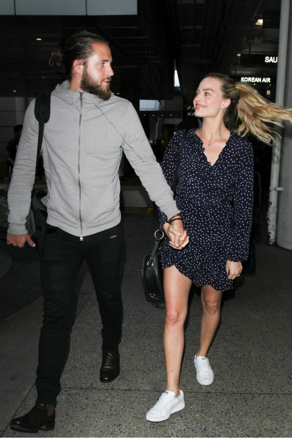 """Margot Robbie in <a href=""""http://realisationpar.com/the-alexandra-navy-star/"""">Realisation</a> and her new husband Tom Ackerley"""