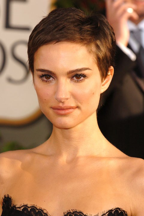 <strong>NATALIE PORTMAN</strong>  <br><br> After shaving her head for *V for Vendetta*, Natalie Portman's pixie cut became one of the most iconic red carpet hair moments of all time. At the Golden Globes that year, she balanced the short crop with voluminous black lashes.