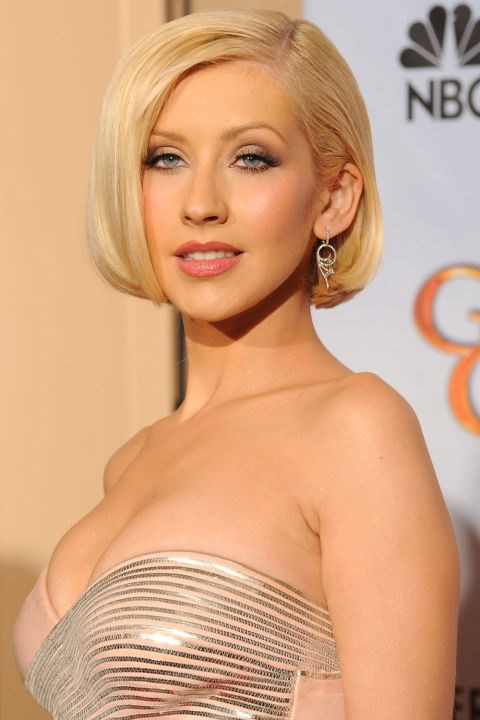 <strong>CHRISTINA AGUILERA</strong> <br><br> We've seen Christina Aguilera take on a number of beauty personas, but our favorite is this 2010 Globes look that showed a more sophisticated side of the singer.