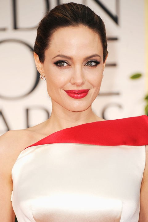 <strong>ANGELINA JOLIE</strong>  <br><br> Angelina Jolie in a bright red lip will land on every best list—guaranteed.