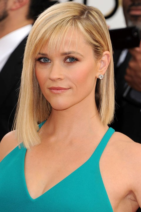 """<strong>REESE WITHERSPOON</strong>  <br><br> An angled bob, deep side-part, and wispy bangs made a big beauty statement for Reese Witherspoon in 2014.  <br><br> [*Harper's BAZAAR US](http://www.harpersbazaar.com/beauty/hair/g8322/best-golden-globes-beauty-looks