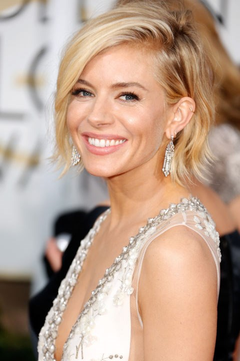 <strong>SIENNA MILLER</strong> <br><br> Short, messy, and rumpled hair never looked as glamorous as it did on Sienna Miller in 2015.