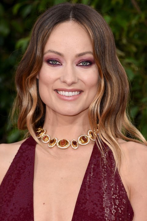 <strong>OLIVIA WILDE</strong> <br><br> Olivia Wilde matched her maroon eyeshadow to her dress and jewels at the 2016 awards ceremony.