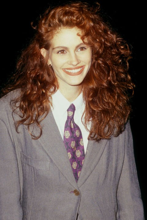 <strong>JULIA ROBERTS</strong>  <br><br> Julia Roberts' famous red curls turn a very '90s suit and tie into a timeless and quirky red carpet look.
