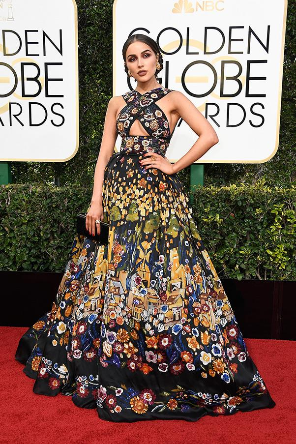 "<strong>Olivia Culpo in Zuhair Murad</strong><br><br> ""This is an Entrance Maker of a dress, and no mistake, but not there's not a whiff of the cynical, sheeny box-ticker about it. So she's to be applauded for that. It's got a lot going on, from the bandito bodice to the big-spender-at-the-Bulgarian-quilters'-fair pattern, but I feel the centre holds. She wears it well. Her bio says cellist and beauty queen, so she's a proven master at convention-busting."" - Tom Lazarus, chief subeditor<br><br> ""After this year's Frida Kahlo exhibition at AGNSW I'm seeing Mexican styling everywhere and I love the drama of this Mexican-feeling Zuhair Murad dress. I'd love to take this for a twirl on the dance floor."" - Eliza O'Hare, travel and culture editor"