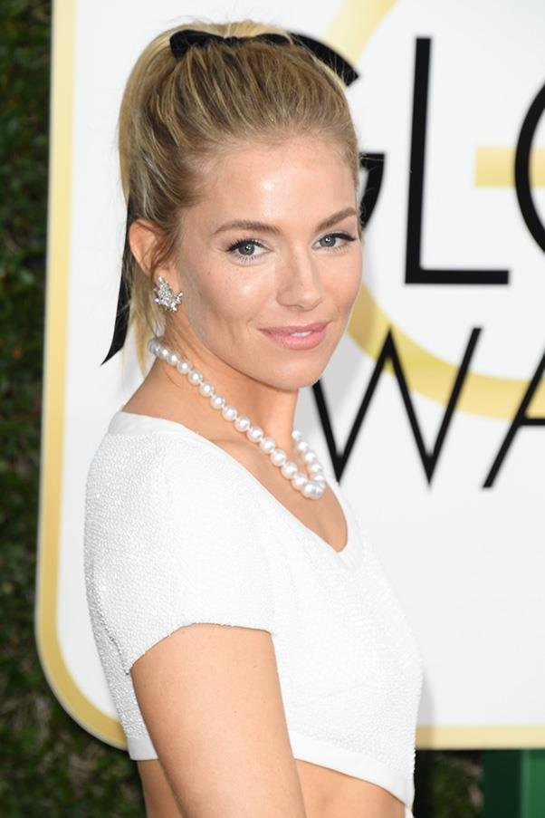 <strong>Ribbons</strong><br><br> Ribbons had a major moment on the red carpet, whether used as a hair-tie (Sienna Miller and Riley Keogh) or a neck-tie (Michelle Williams).<br><br> Sienna Miller in Michael Kors Collection