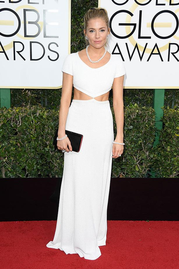 Sienna donned a cut-out Michael Kors stunner on the 74th Golden Globes red carpet, 2017.