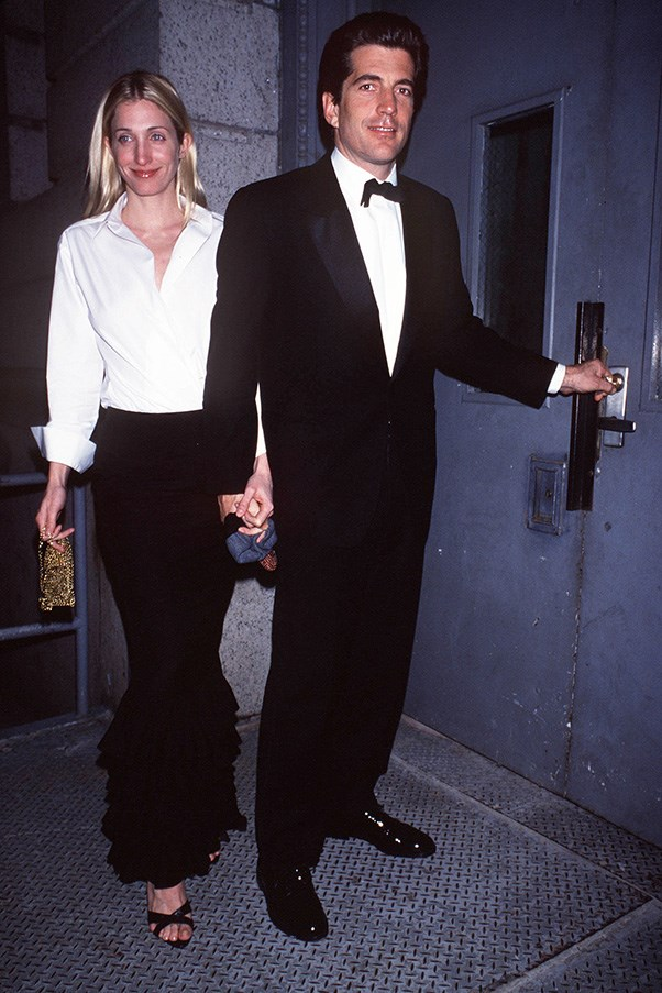 With husband John F. Kennedy outside their New York apartment, 1999